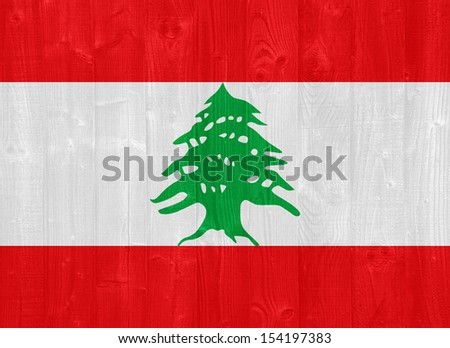 gorgeous Lebanon flag painted on a wood plank texture