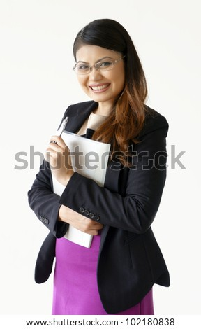 Gorgeous Math teacher smiling while holding pen and files - stock photo
