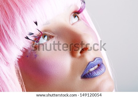 Gorgeous model beautiful women with perfect art make up and long false eyelashes made from feathers and pink hair - stock photo
