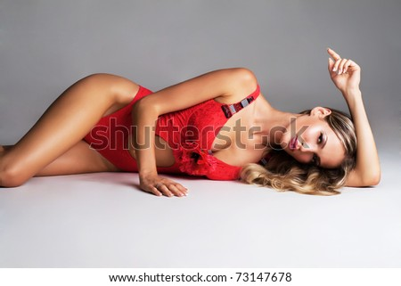 Gorgeous model in fashionable red clothing - stock photo