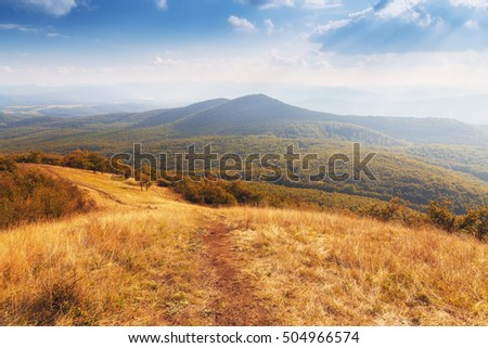 Gorgeous mountain scenery with blue cloudy sky