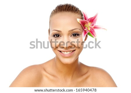 Gorgeous pretty spa woman with lily flower