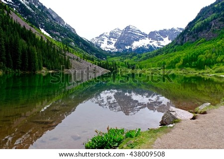 Gorgeous Reflection of Snow Capped Mountains in Lake.  Maroon Bells reflection in Maroon lake near Aspen and  Snowmass Village,  Colorado State, USA.  - stock photo