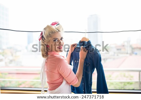 Gorgeous retro housewife hanging denim jacket