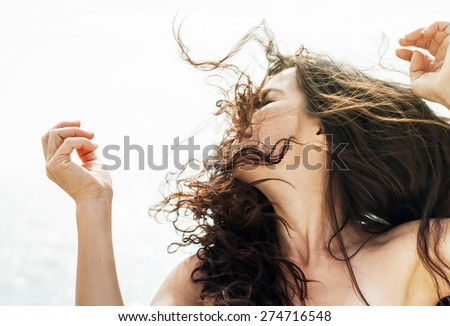 Gorgeous Romantic Girl Outdoors. Long Hair Blowing in the Wind. Backlit, Warm Color Tones - stock photo