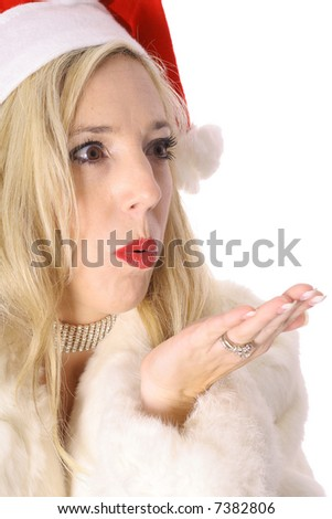 gorgeous santa woman blowing kiss