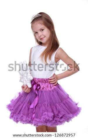 Gorgeous smiley little girl holding huge white snowflake on Beauty and Fashion theme