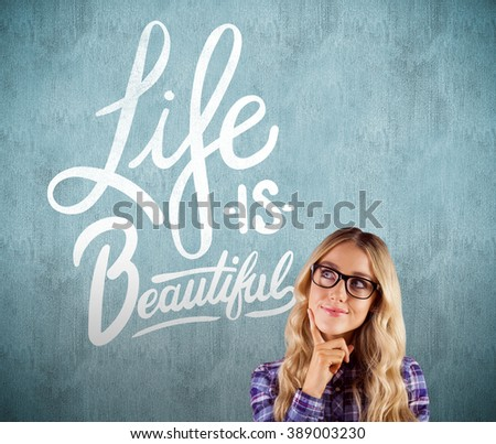 Gorgeous smiling blonde hipster daydreaming against white and grey background - stock photo