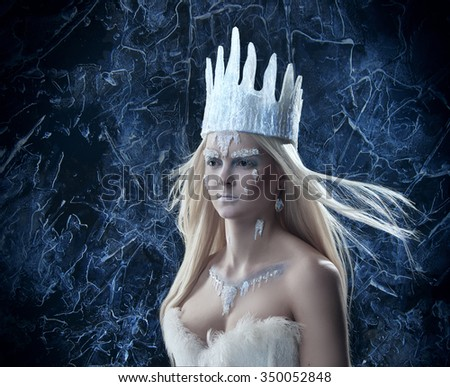 Gorgeous Snow queen. Young woman in creative image with silver and white artistic make up and crown - stock photo