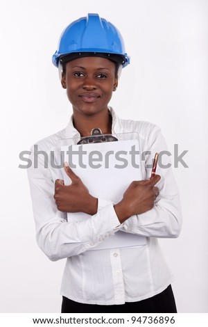 Gorgeous South African woman with a notepad and hard-hat - stock photo
