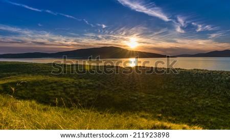 Gorgeous sunset on the beach. Luskentyre, Isle of Harris, Scotland - stock photo