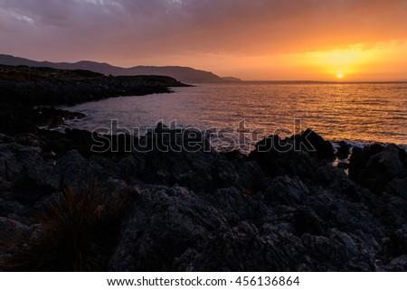 Gorgeous sunset on the coast of Crete - stock photo