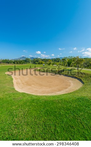 Gorgeous view at the beautiful golf course with sand bunker. Vertical. - stock photo