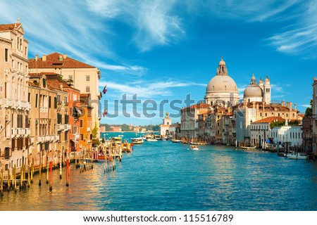 Gorgeous view of the Grand Canal and Basilica Santa Maria della Salute during sunset with interesting clouds, Venice, Italy