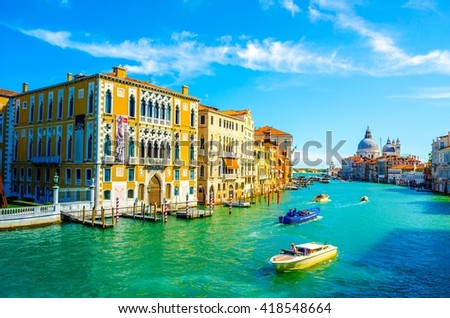 Gorgeous view of the Grand Canal and Basilica Santa Maria della Salute with interesting clouds, Venice, Italy - stock photo