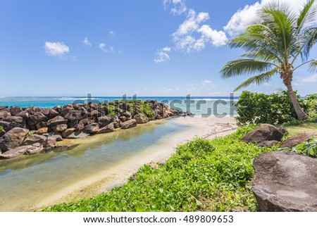 Gorgeous views of Rarotonga turquoise water beaches with palms and white sand. Cook Islands, South Pacific Ocean.