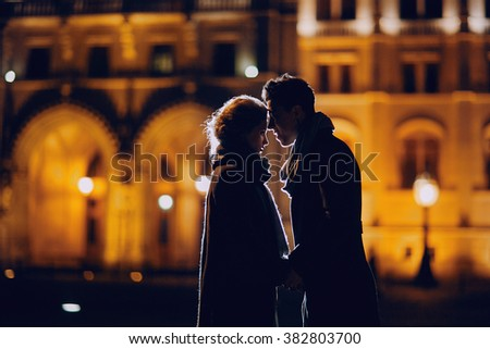 gorgeous wedding couple walking in Budapest at night