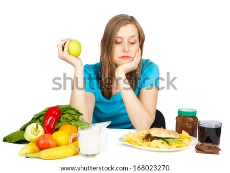 Gorgeous woman choosing the right way to loose weight. - stock photo