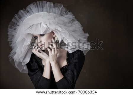 Gorgeous woman in big hat - stock photo