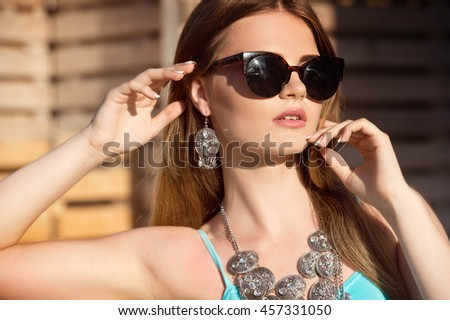 Gorgeous woman in sunglasses outdoor - stock photo