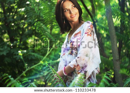 Gorgeous woman in tropical forest - stock photo