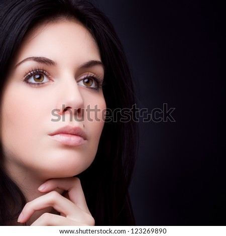 gorgeous woman portrait - hand on chin - stock photo