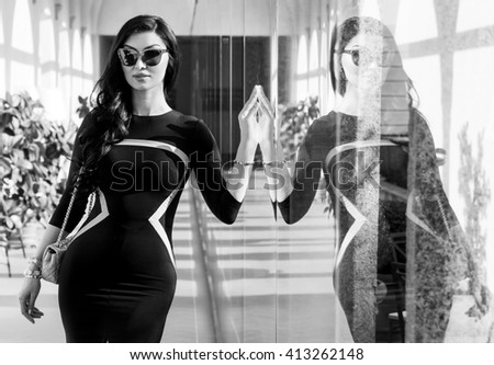 Gorgeous woman portrait wearing dress and sunglasses with reflection monochrome - stock photo