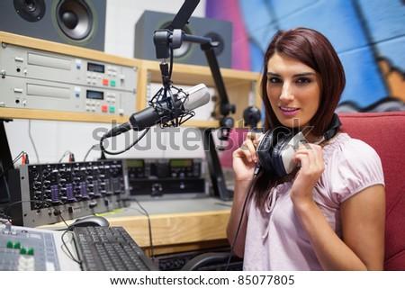 Gorgeous woman posing in a studio - stock photo