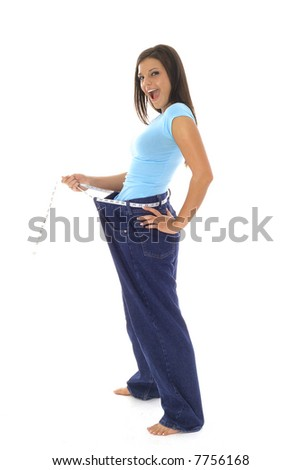 gorgeous woman showing off her weight loss in jeans