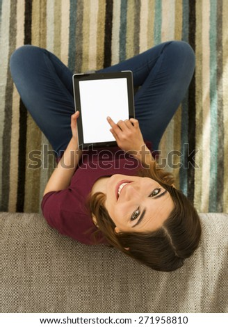 Gorgeous woman using a digital tablet indoors, with copy space  - stock photo