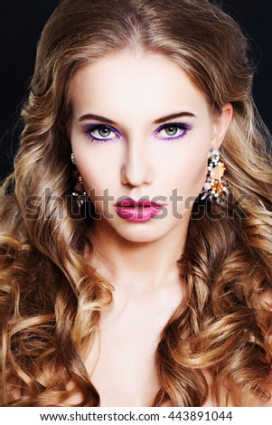 Gorgeous Woman with Curly Hairstyle and Makeup - stock photo