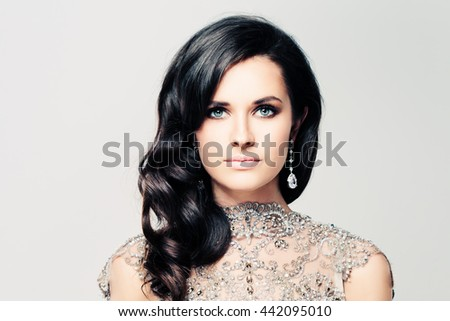 Gorgeous Woman with Curly Permed Hair and Makeup - stock photo