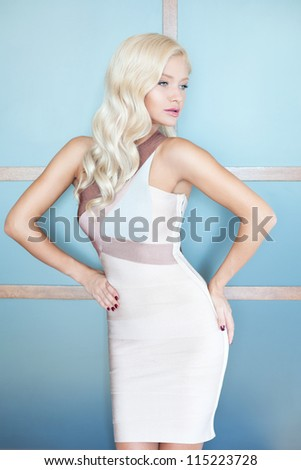 Gorgeous woman with golden hair - stock photo
