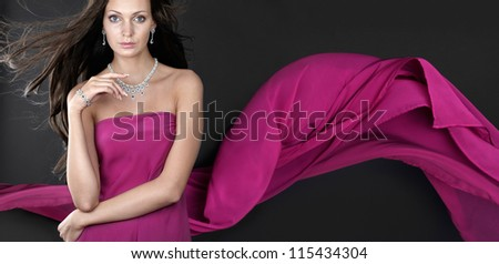 Gorgeous woman with jewellery on dark background. Banner. - stock photo