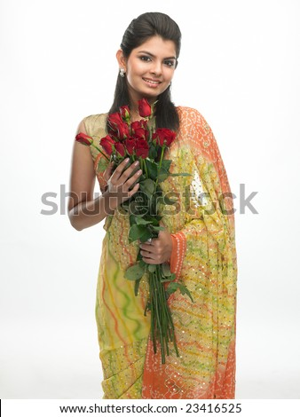 Gorgeous woman with red roses - stock photo