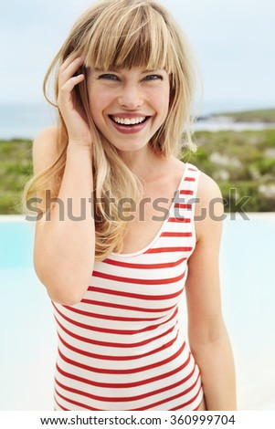 Gorgeous young blond woman in swimsuit, portrait - stock photo