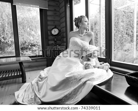 Gorgeous young bride looking out of the window