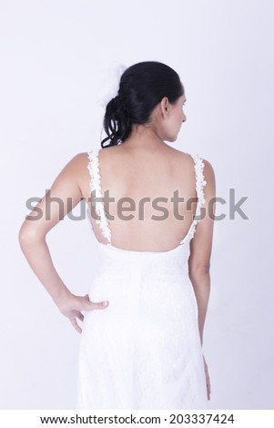 Gorgeous young Brunette Bride showing her Sexy Back with a dress - stock photo