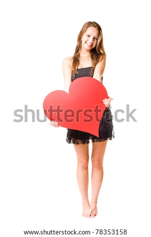 Gorgeous young brunette fooling around with large red heart shape, isolated on white background.