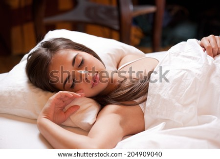 Gorgeous young brunette having a good night's sleep.