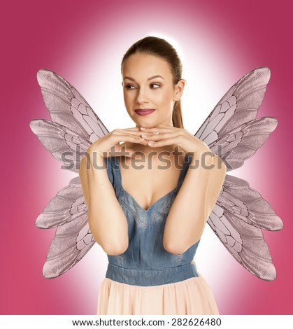 Gorgeous young brunette woman as a fairy.  - stock photo