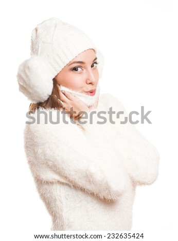 Gorgeous young brunette woman dressed in all white warm clothes.