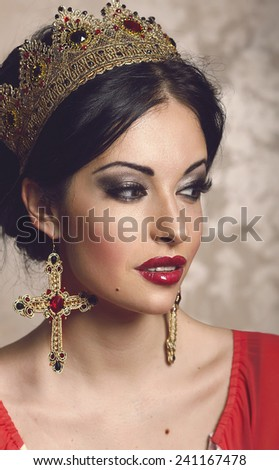 Gorgeous young brunette woman in golden crown portrait - stock photo