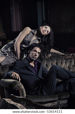 Gorgeous young couple in a stylish interior - stock photo