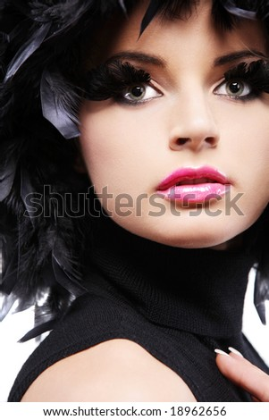 Gorgeous young girl in black feathers. - stock photo