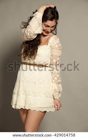 Gorgeous Young Happy Brunette Wearing White - stock photo