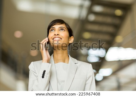 gorgeous young indian office worker making phone call - stock photo