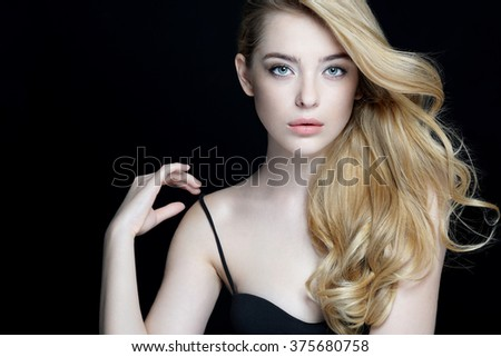 Gorgeous young model, youth and skin care concept. Close-up of an attractive girl of European appearance on dark background. - stock photo