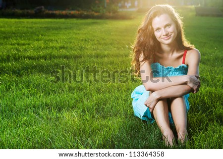 Gorgeous young pretty woman in spring park - stock photo
