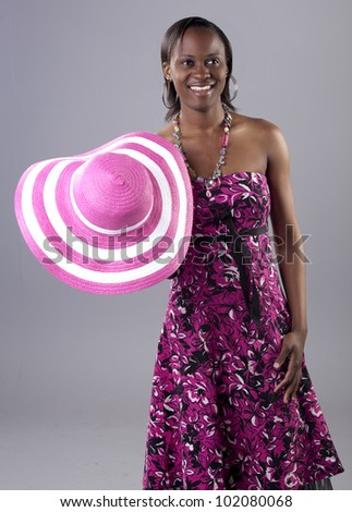 Gorgeous young South African woman in a bright dress - stock photo